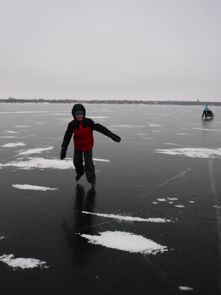 Ice skating on Lake Monona. The iceboats were cookin'.