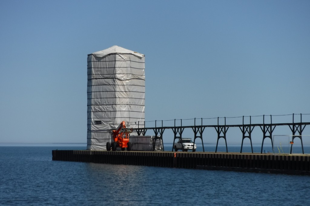 Entrance to Manistee. One of their channel marker is under construction; from the lake, we thought it was a grain silo and a tractor. Agriculture on the pier!