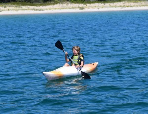 Independent kid on a kayak, South Manitou