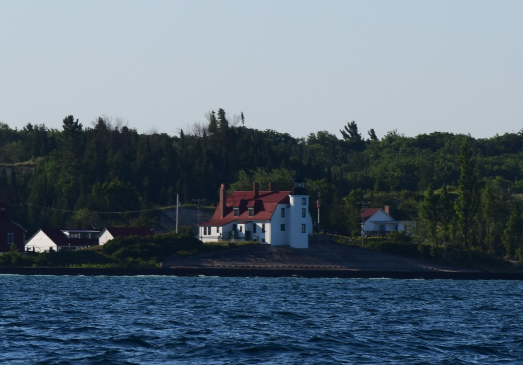 The lighthouse at Point Betsie, from the water in the early morning.