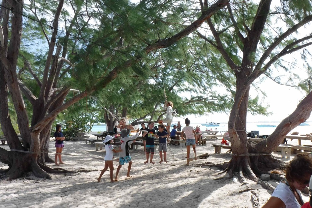 Cruising kids working the slackline and rope swing at the Chat and Chill