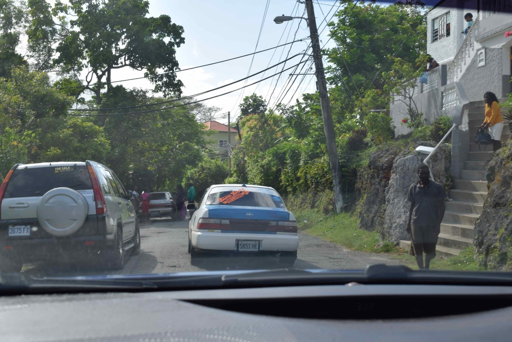 In this photo, we're following the car on the right. On the left is what's considered a perfectly acceptable parking job in Jamaica. Keep in mind that this is a major highway, with, I'm sure, a blind corner just ahead.