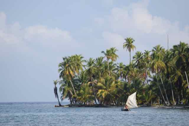 Traditional Guna sailboat off Green Island