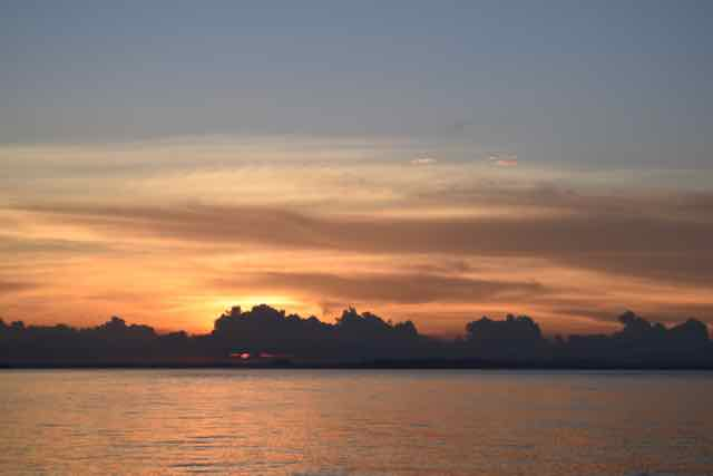 Sunset from Taboga. In the Bay of Panama, even though we're on the Pacific, the sun sets over land.