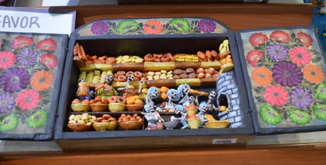 I had to force myself to walk away from this miniature cabinet of partying skeletons in the bakery.