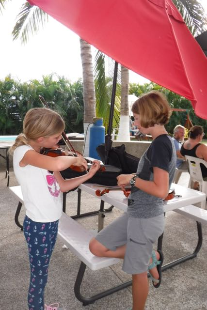 F has moved on to violin instruction. Music Con Brio techniques, of course!