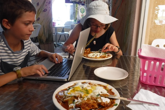 Kids and I enjoying internet and chilaquiles.