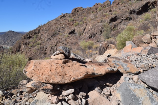 "One of the ""bell rocks"" up in the hills around Playa Burro; the high iron content makes the solid rocks resonate like a bell"